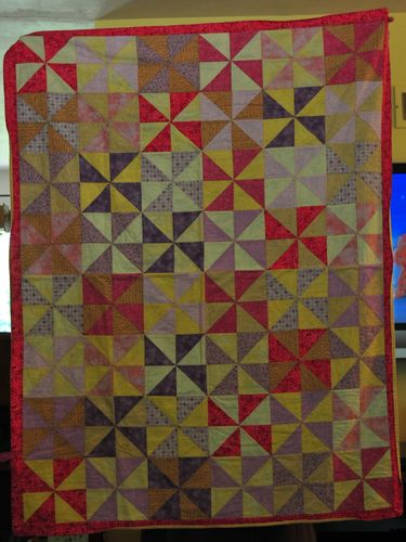 Pink and yellow pinwheel quilt